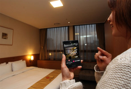 NFC smartphones open doors and control room systems like in the Hotel Sky Park Central in Seoul/South Korea