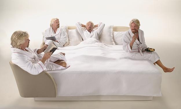 Sir Richard Branson in Virgin Hotels signature lounge bed